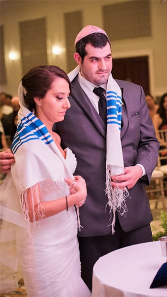 Jewish Wedding couple with tallitot wrapping