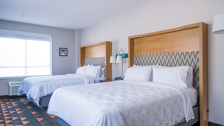 two queen beds in a standard room at the Holiday Inn and Suites in Drexelbrook