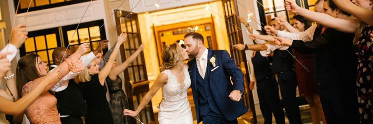 Wedding Couple Exiting Drexelbrook Grand Ballroom and Lobby