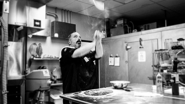 Chef Andrew making pizza in the traditional way.