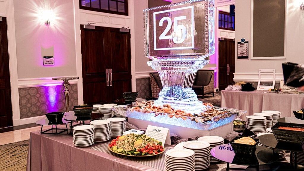 A Seafood Buffet under an illuminated ice sculpture