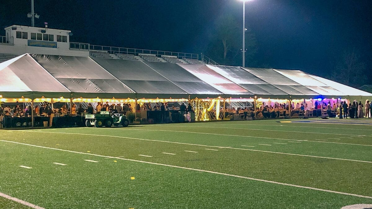 Outdoor Large tent for Prom on the football field.